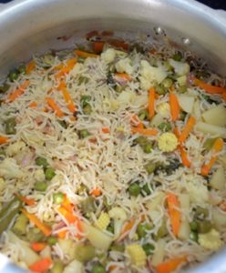 making vegetabe pulao in pressure cooker