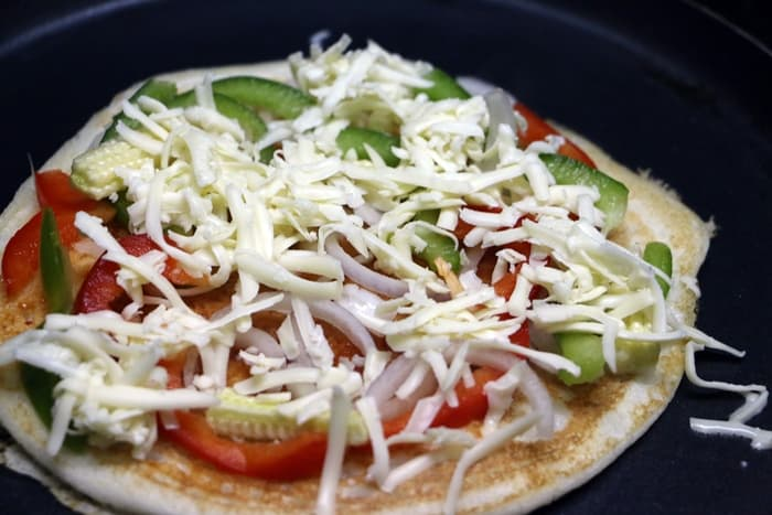 dosa pizza topped with cheese