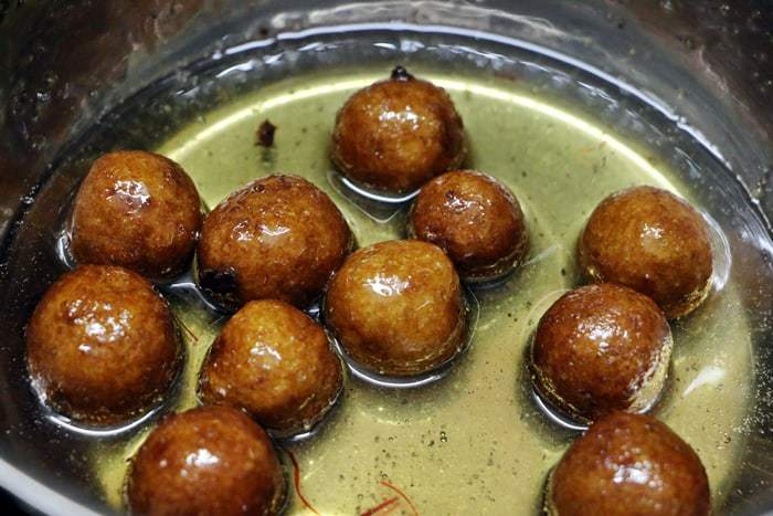 soaking bread gulab jamun in sugar syrup