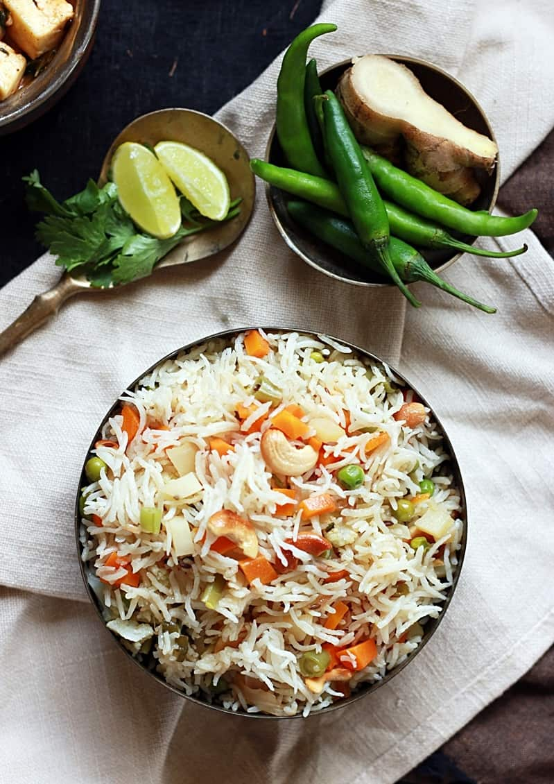 Overhead shot of delicious veg pulao served in a copper bowl