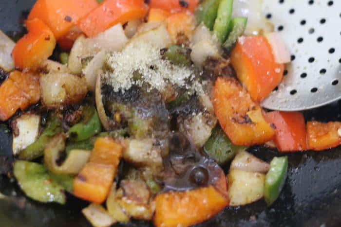 soy sauce, sugar, chili sauce, vinegar added to sauteed vegetables
