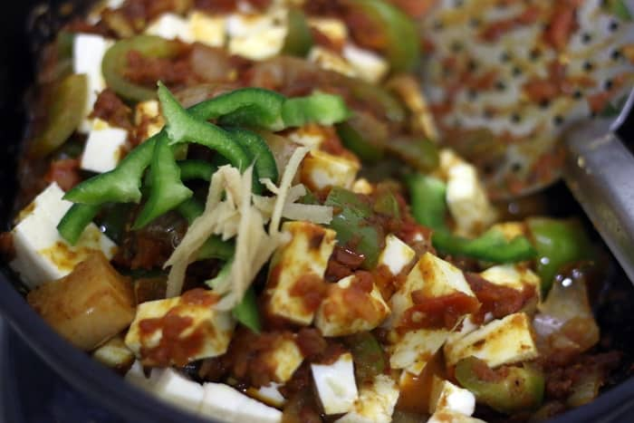 kadai paneer garnished with ginger julienne