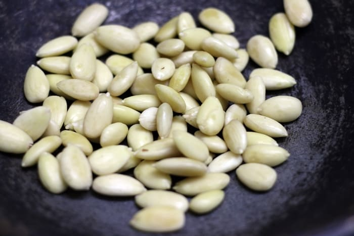Dry roasting blanched almonds