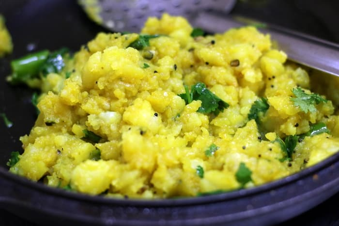boiled and mashed potatoes sauteed with spices in a cast iron pan/