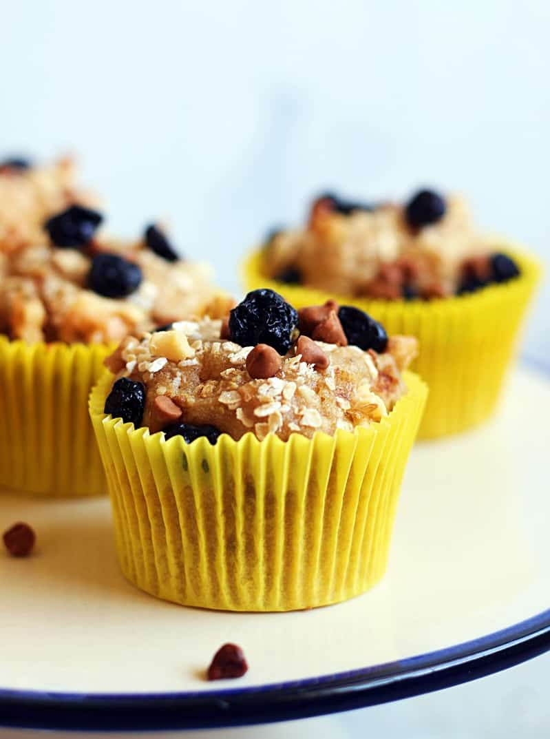 vegan banana muffins recipe- vegan muffin topped with dried berries and oats.