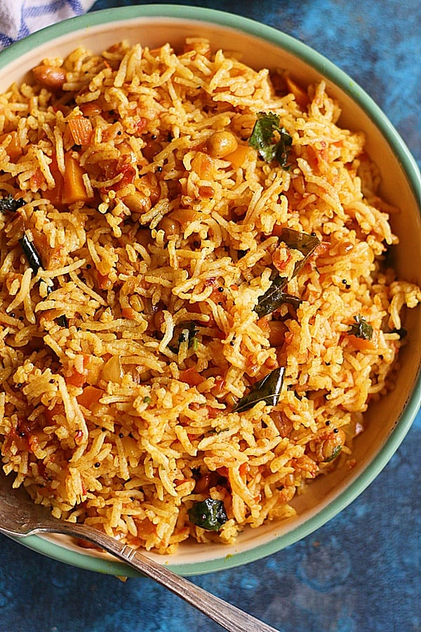 south Indian tomato rice or thakkali sadam from Tamil nadu served in a enamel plate
