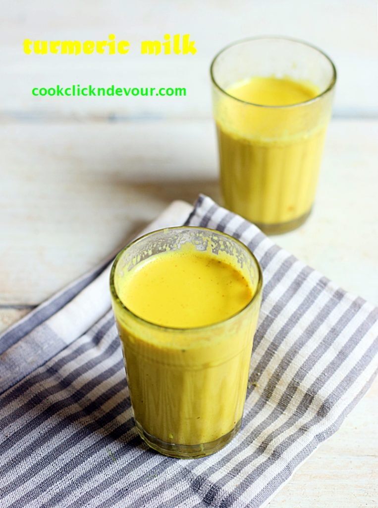 healing and immunity boosting turmeric milk served warm in two glasses