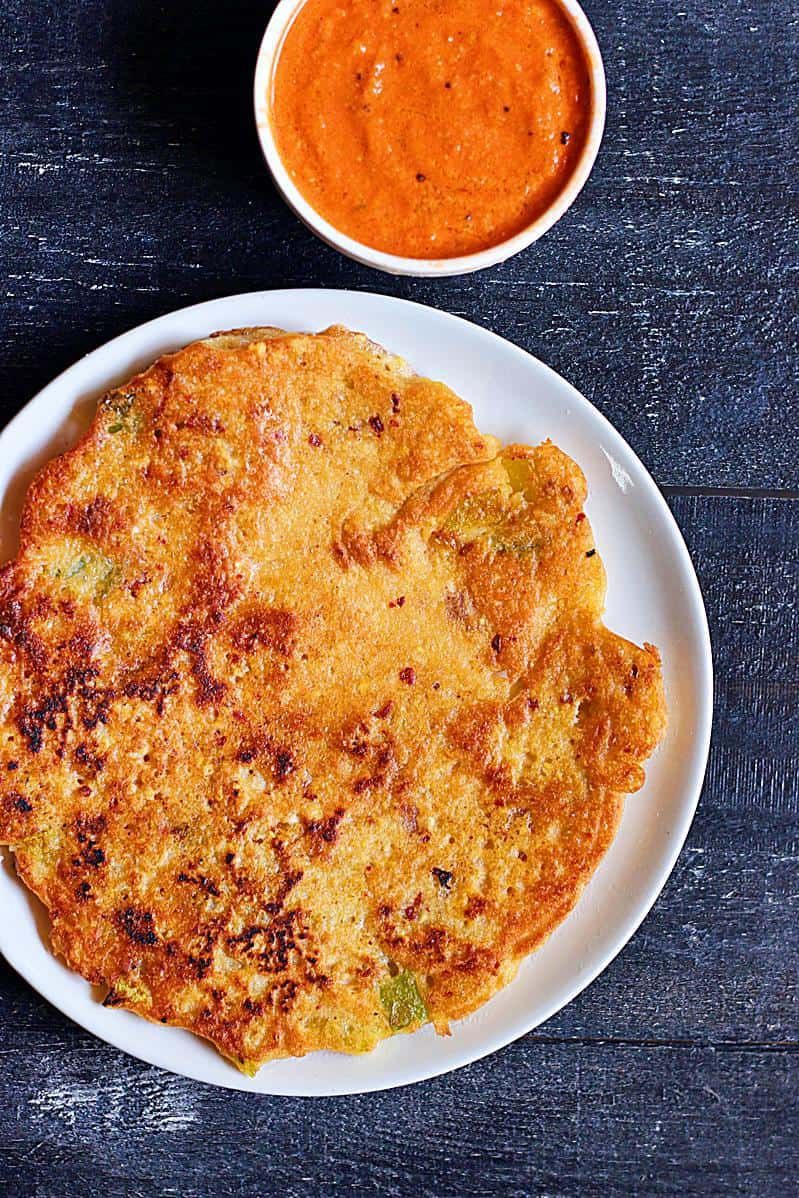 South Indian adai dosa ith tomato chutney on a white plate