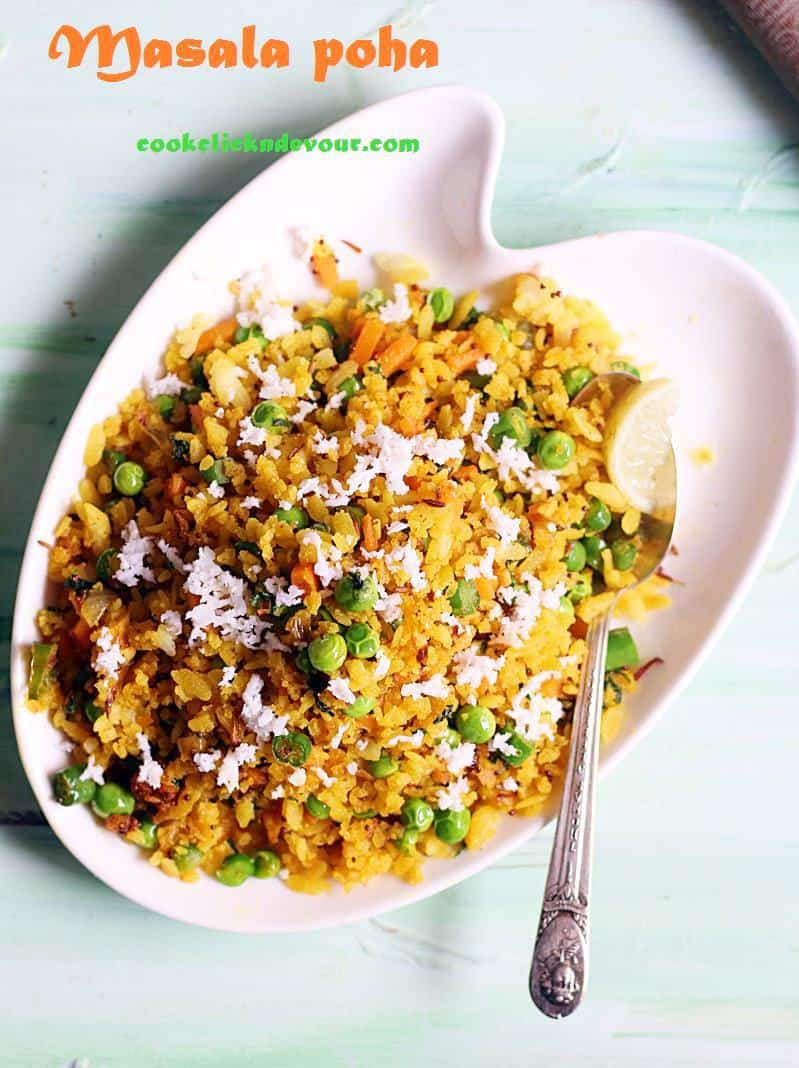 masala poha recipe- a white plate containing poha or rice flake with Indian spices