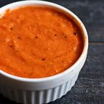 tomato ginger chutney recipe- A small white bowl with tangy and flavorful tomato chutney flavored with ginger.