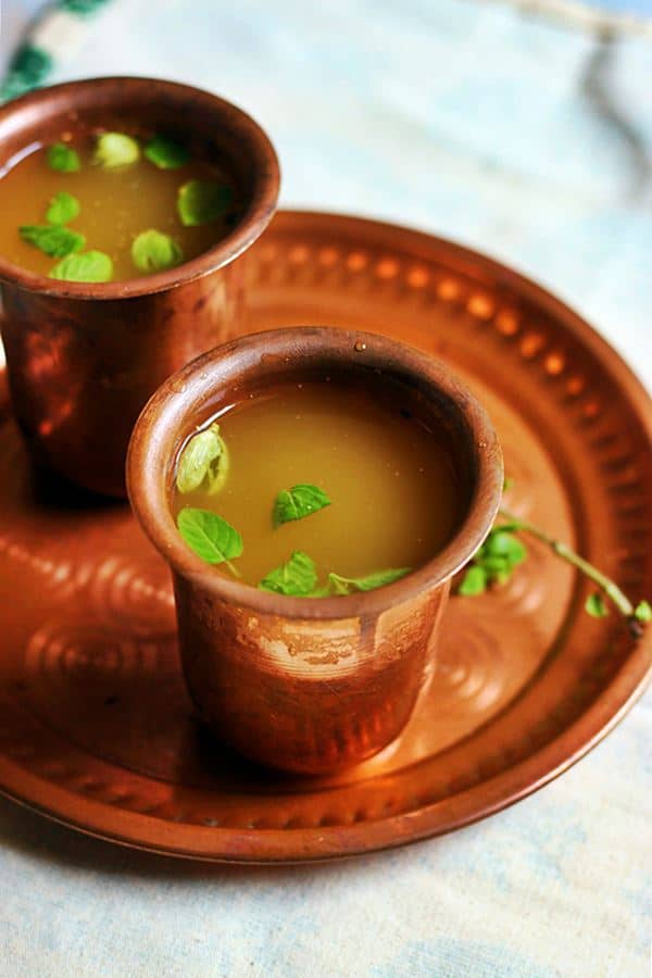 healthy and refreshing panakam (south Indian summer drink) with jaggery, water, lemon juice served in a copper tumbler