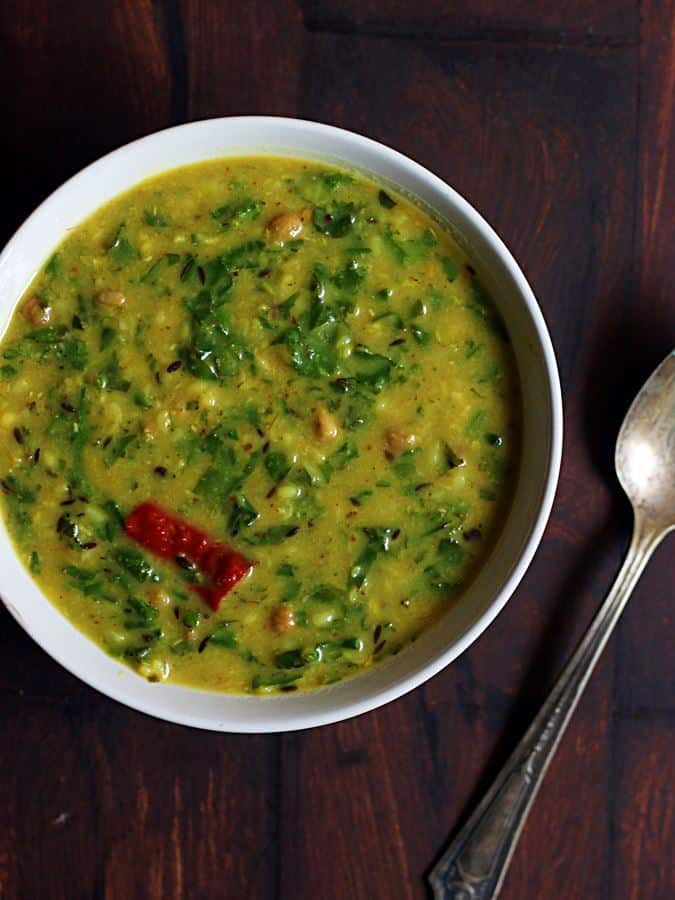 palak dal recipe- Indian style delicious lentils cooked with spinach leaves served with rice for lunch.