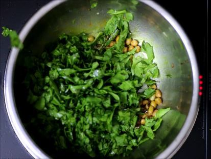 adding palak leaves for palak dal recipe
