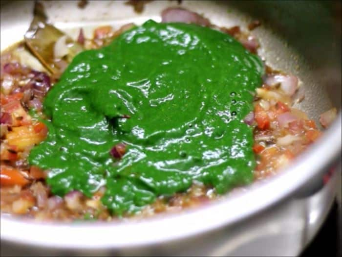 Adding blanched spinach puree or palak puree to sauteed onion tomato masala