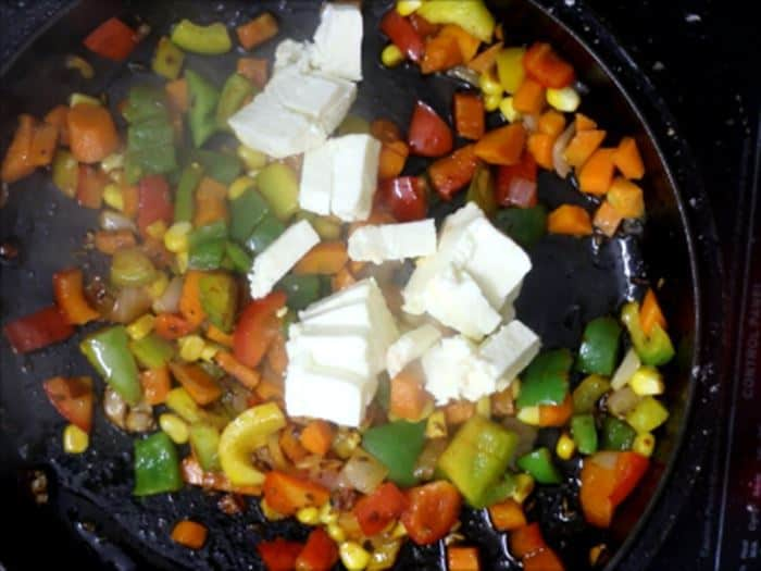 Adding paneer to the cooked veggies-paneer fry recipe