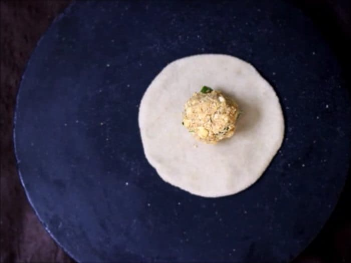 paneer stuffing placed on rolled paratha