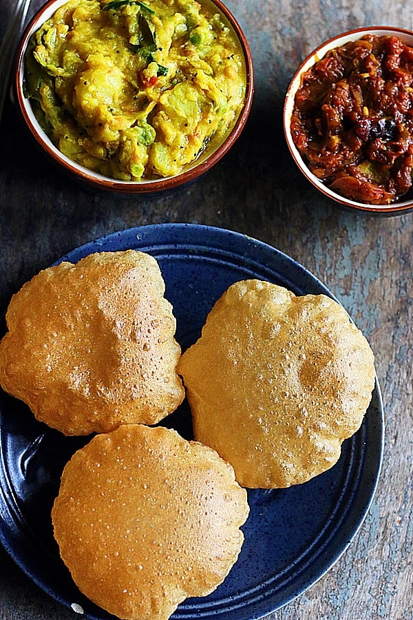 crispy poori served with curries and side dish