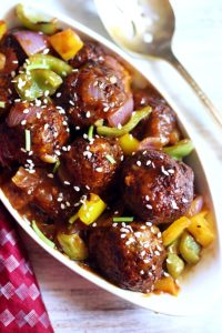 crispy veg manchurian served in a white ceramic bowl with a spoon