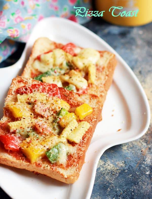 pizza toast recipe-pizza toast served on a white plate