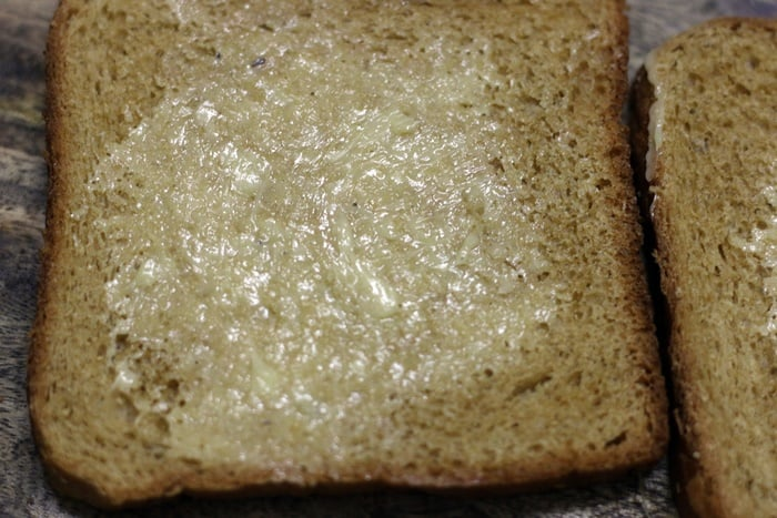 buttered bread slices making cheese toast sandwich recipe