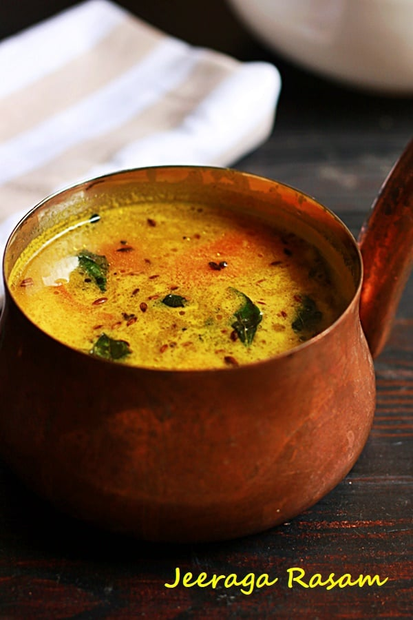 closeup shot of jeera rasam in a copper sauce pan