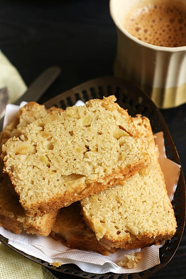 Closeup shot of moist and soft eggless apple cake served with tea