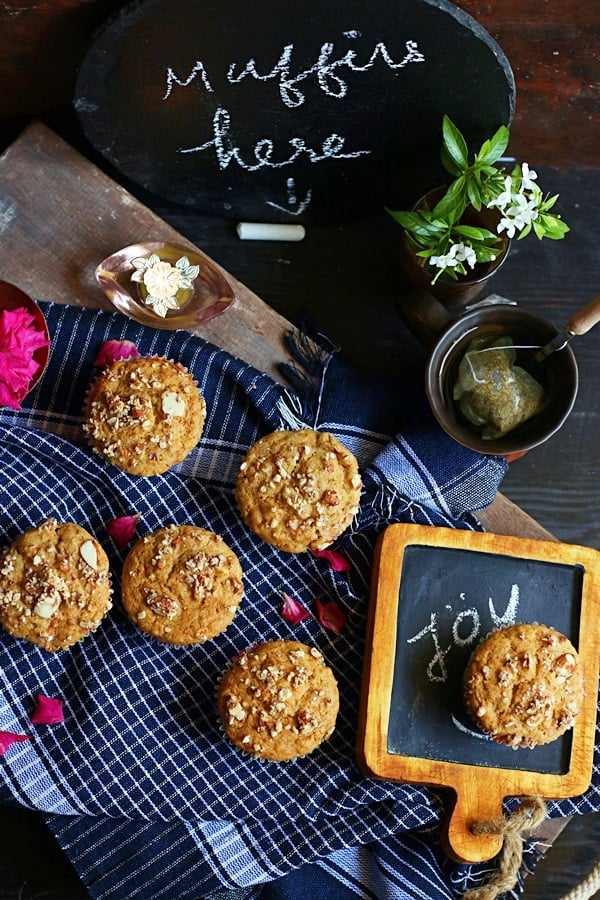 carrot muffins served for breakfast with a chalkboard handwritten menu