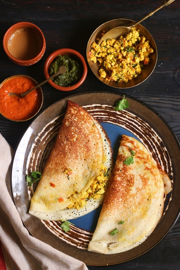 Paneer dosa for breakfast served in a blue plate with chutney, sambar and coffee