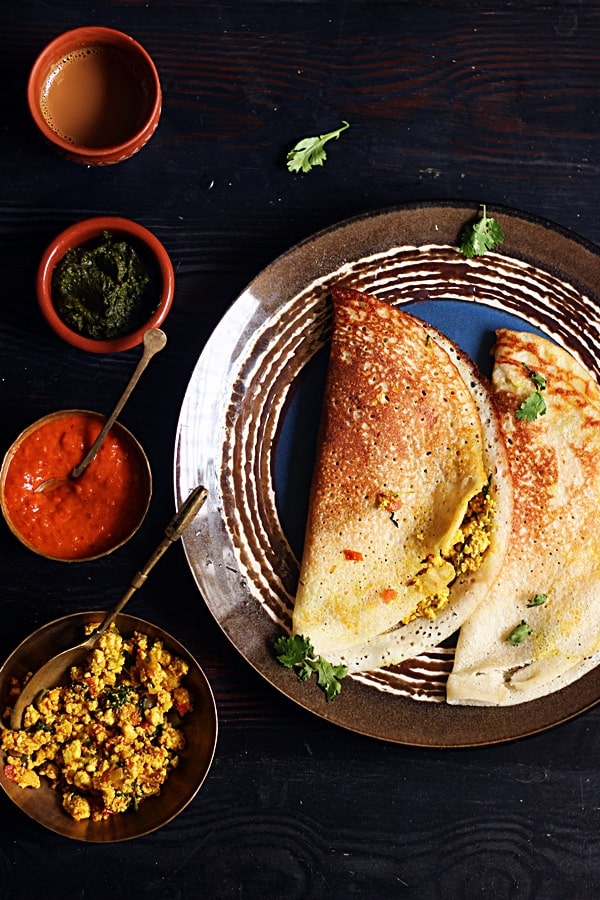 Paneer masala dosa served with chutney, sambar and coffee