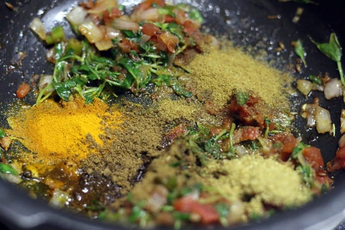 Adding spice powders to paneer filling for making paneer dosa