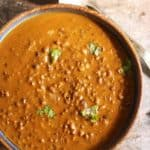Closeup shot of creamy maa ki dal or kali dal served in a ceramic bowl for dinner