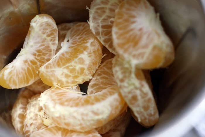 peeled and segmented orange for ganga jamuna juice