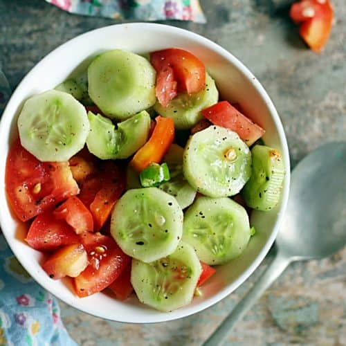 This cucumber tomato salad is so delicious with fresh crispy cucumbers, sweet tomatoes and a mild dressing. It is a summer staple and pairs beautifully with any summer meals