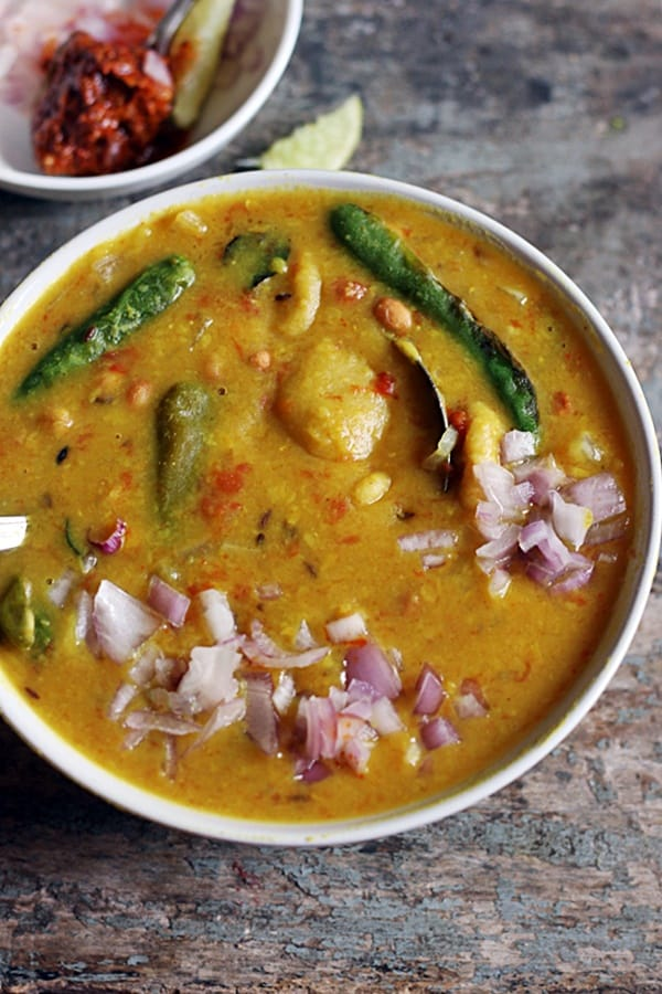 Closeup shot of Gujarati dal dhokli served in a white bowl