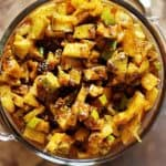 closeup shot of freshly made instant mango pickle in a glass container