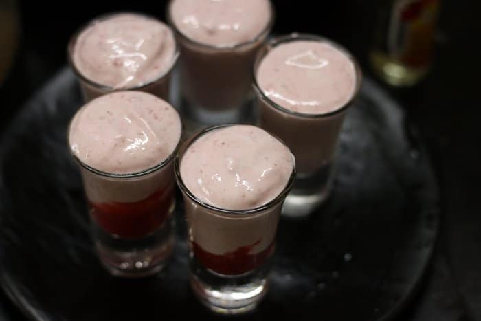 strawberry mousse divided among serving glasses