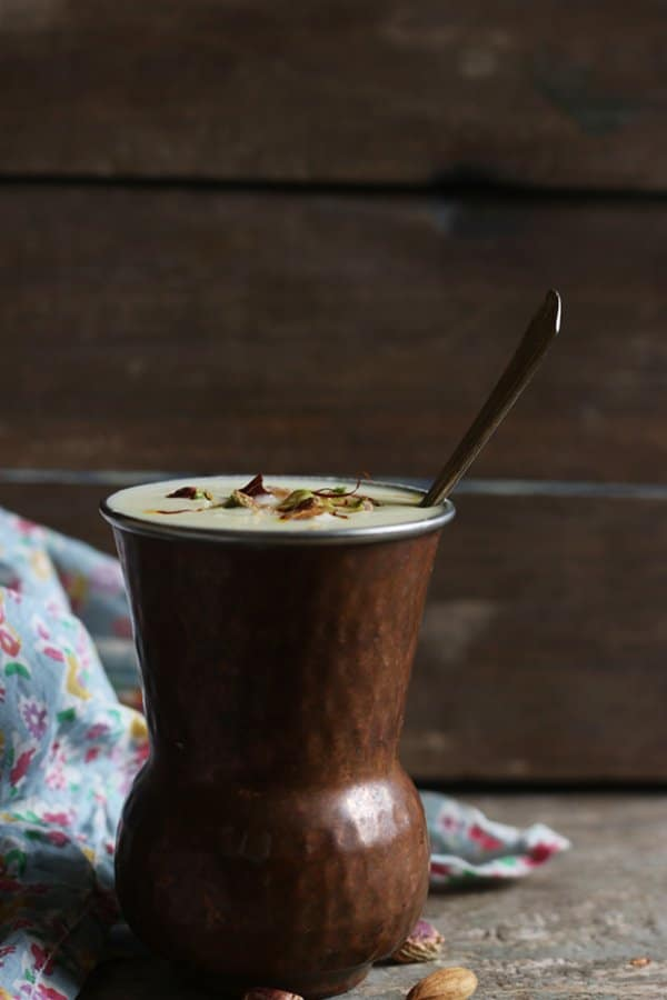 Pinjabi sweet lassi served in copper tumbler with a big spoon to dig in!