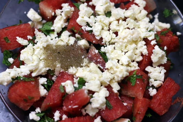 Making watermelon salad recipe