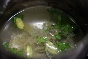 Simmering ginger cardamom in water