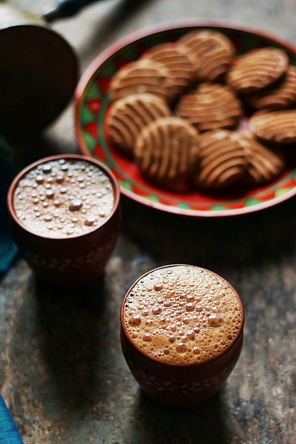 Tandoori chai served in kulhad with biscuits