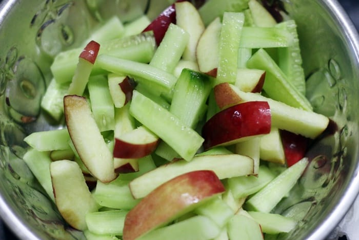 making apple and cucumber salad