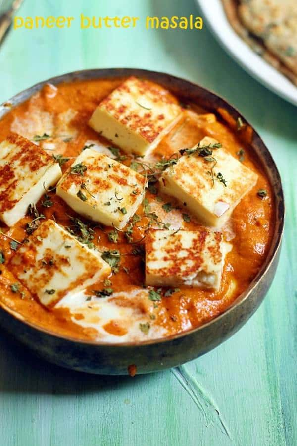 restaurant style paneer butter masala served in a copper bowl