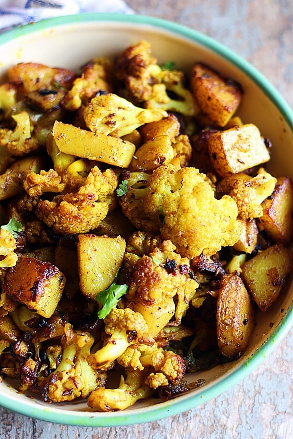 easy and best aloo gobi served in a green pan