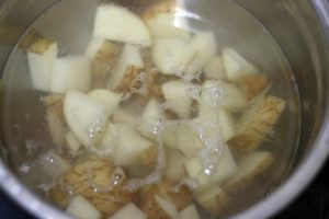 cubed potatoes soaked in water