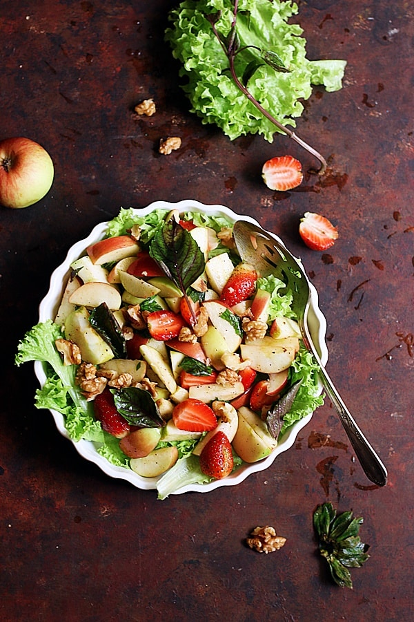 easy apple walnut salad served in a ceramic bowl.