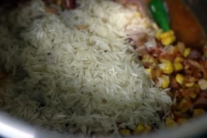 drained rice added to vegetables