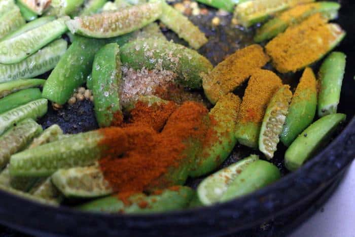 spice powders and salt added to chopped ivy gourd
