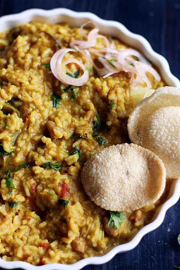 vegan vegetable masala khichdi served with papad in a ceramic plate