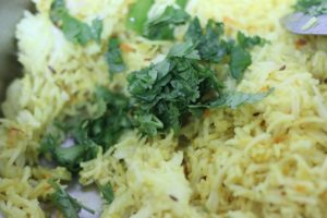 coriander leaves added to turmeric rice.